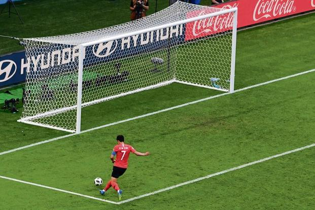 South Korea's Son Heung-min scores their second goal against Germany in a group match on 27 June