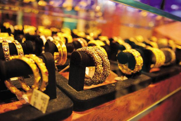 Global spot gold rate was 0.3% lower at $1,248.98 an ounce. Photo: Mint