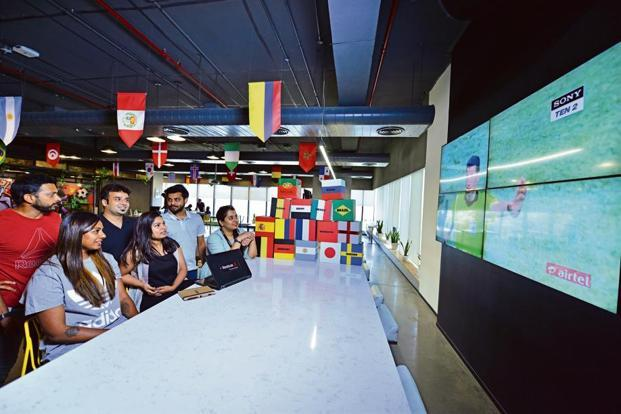 Employees watch a game at the Adidas office in Gurugram. Photo: Pradeep Gaur/Mint