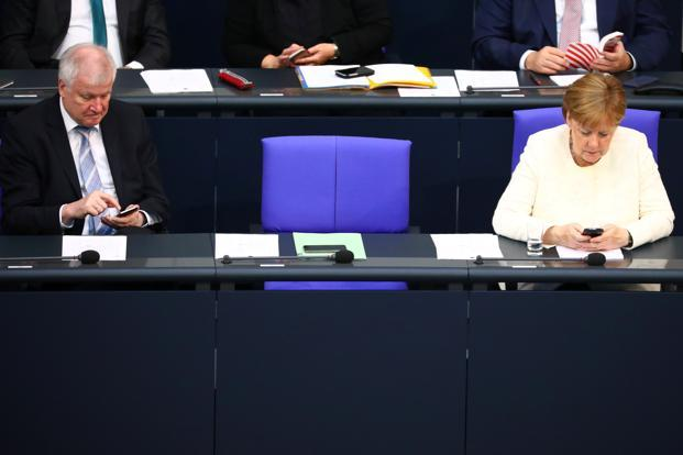 Angela Merkel and interior minister Horst Seehofer, her antagonist who had threatened to resign, ended their two-week standoff late Monday. Photo: Reuters