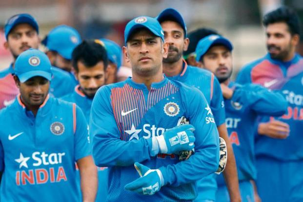 Mahendra Singh Dhoni and Virat Kohli constantly coach players to get the best out of them. Photo: AFP