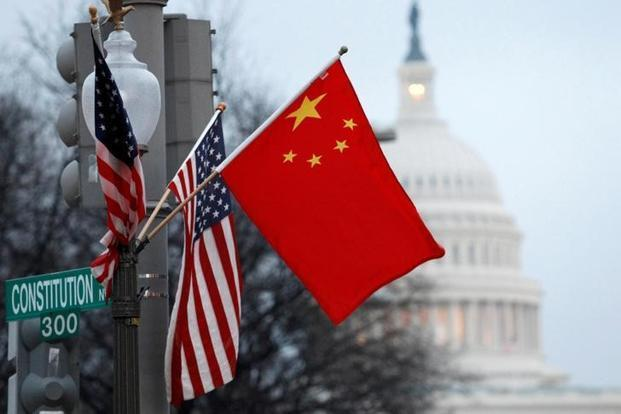 US plans to go ahead with tariffs on $34 billion of imports from China on Friday. Photo: Reuters