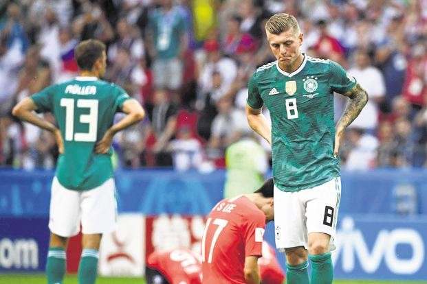 Germany's forward Thomas Mueller (left) and midfielder Toni Kroos react after their loss to South Korea in a Group F match on 27 June. The loss sent the reigning champions packing from the group stage. Photo: AFP