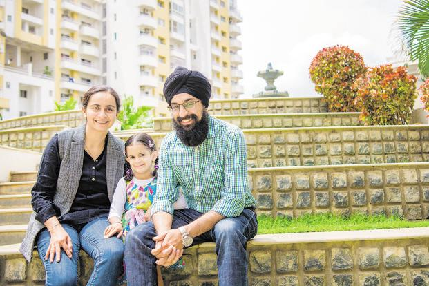 Inderdeep Kaur and Ishkaran Singh with their daughter, Sehej. Photo: Bhaskar Varma/Mint