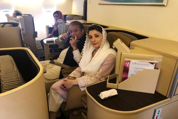 Ousted Pakistani Prime Minister Nawaz Sharif and his daughter Maryam sit on a Lahore-bound flight due for departure, at Abu Dhabi International Airport, UAE on 13 July 2018. Photo: Reuters