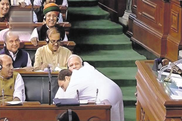 Rahul Gandhi gives Prime Minister Narendra Modi a hug during the no-confidence motion in Parliament on Friday. Photo: PTI