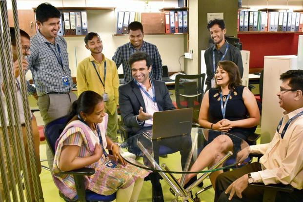 Rohit Srivastav (centre) is now comfortable communicating with colleagues in Kannada. Photo: Jithendra M/Mint