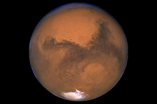 Mars is now cold, barren and dry but used to be warm and wet. It was home to plenty of liquid water and lakes at least 3.6 billion years ago. Photo: Reuters