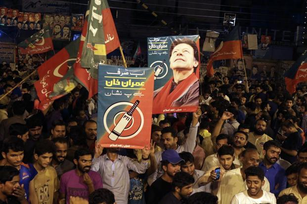 Supporters of Pakistani politician Imran Khan, chief of Pakistan Tehreek-e-Insaf party, celebrate projected unofficial results announced by television channels indicating their candidates' success in the parliamentary elections in Islamabad, on Wednesday. Photo: AP