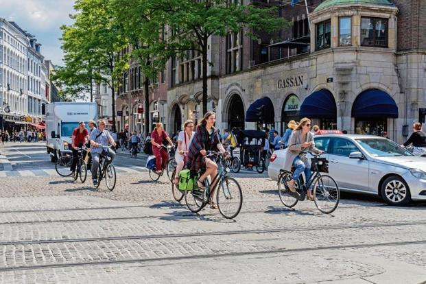 Amsterdam is a cyclist-friendly city, with over 400km of biking paths. Photo: Alamy