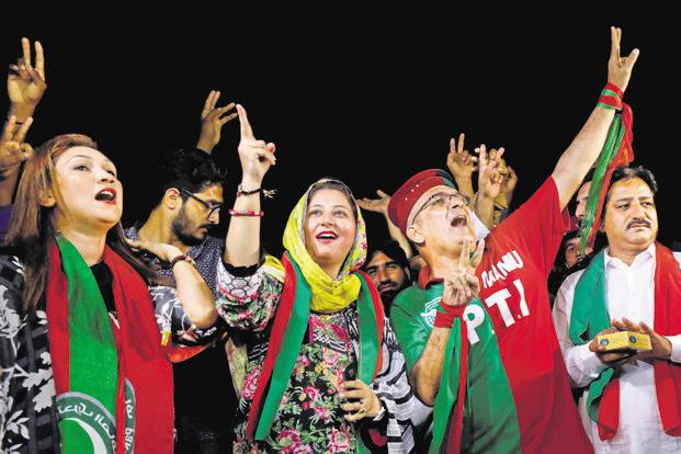 Supporters of cricket star-turned-politician Imran Khan celebrating Pakistan Tehreek-e-Insaf's (PTI) win in Pakistan election in Karachi. Photo: Reuters
