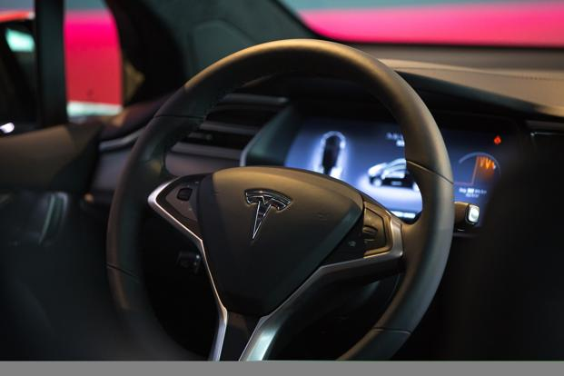 Image result for Tesla cars will play video with a future update