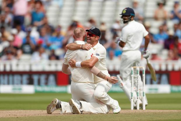 England's Ben Stokes (left) and James Anderson celebrate the wicket of India's Virat Kohli on Saturday. Photo: Reuters