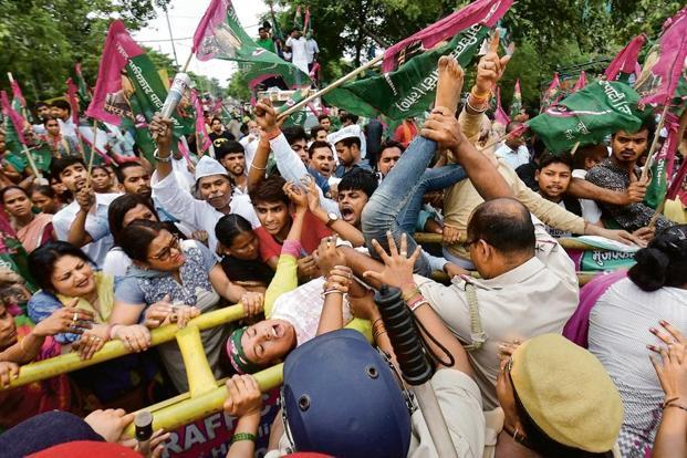 People clash with police at a protest against trafficking and sex trade, in Patna. Photo: PTI.
