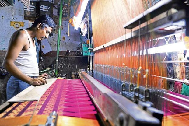 File photo of a weaver in Bengaluru. The Gram Seva Sangh plan to create awareness around the ongoing struggle of weavers in North Karnakata to mark the National Handloom Day.Photo: AFP.