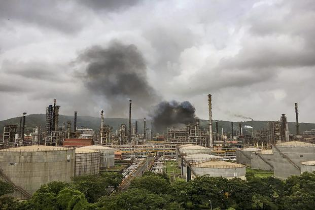 Smoke is seen after a fire broke out at a BPCL refinery in Chembur, Mumbai, on Wednesday. Photo: AP