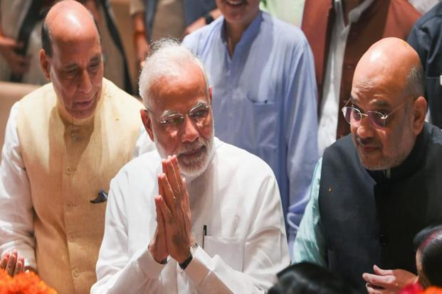 Prime Minister Narendra Modi, BJP President Amit Shah and Rajnath Singh during BJP Parliamentary Party meeting at Parliament House, in New Delhi on Tuesday. Photo: PTI
