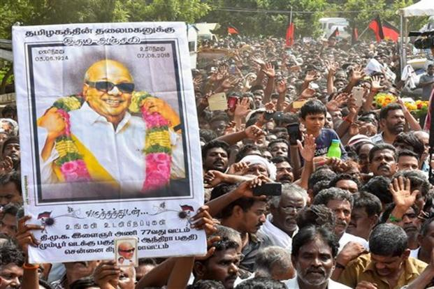 People gather to pay their last respects to DMK President M Karunanidhi. Photo: PTI