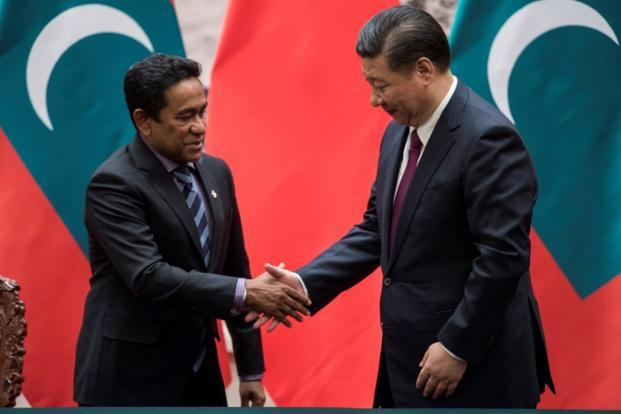Maldives President Abdulla Yameen (left) with Chinese counterpart Xi Jinping. China has rapidly built ties with the tropical island chain as part of its Belt and Road Initiative. Photo: Reuters