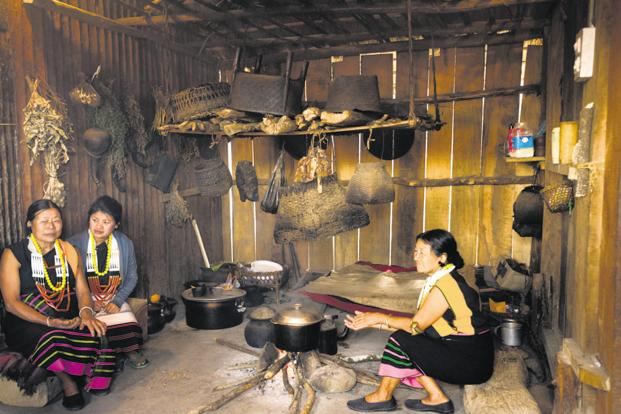 Naga tribeswomen cooking according to age-old methods in the village of Kisama in Nagaland. Photo: Alamy