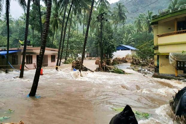 A view of a residential area following a flash flood, triggered by heavy rains, at Kodencheri in Kozhikode district of Kerala. Photo: PTI