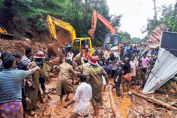 Rescue operations being carried out following a landslide, triggered by heavy rains at Adimali, in Idukki, Kerala on Thursday. Photo: PTI
