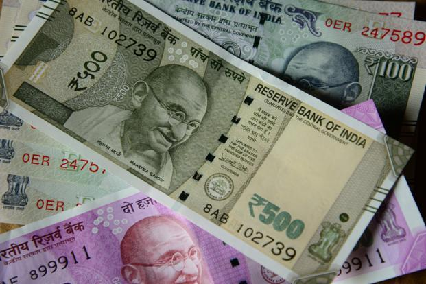 Rupee hits record low, mild RBI intervention seen