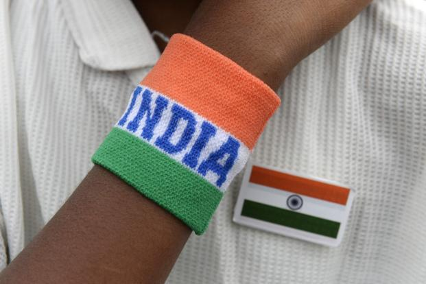 An Indian student wearing his national flag and themed wristband  participates in Independence Day celebrations in