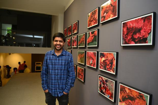 Artist Harshit Agarwal with his work, 'The Anatomy Lesson of Dr Algorithm'. Photo: Ramesh Pathania
