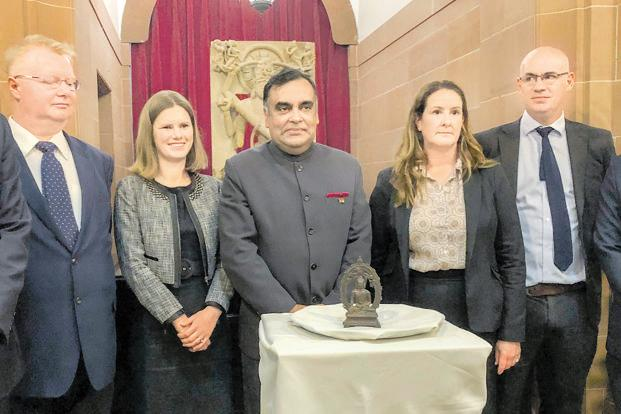 India's high commissioner to the UK, Y.K. Sinha (centre), with the bronze statue of the Buddha. Photo: PTI