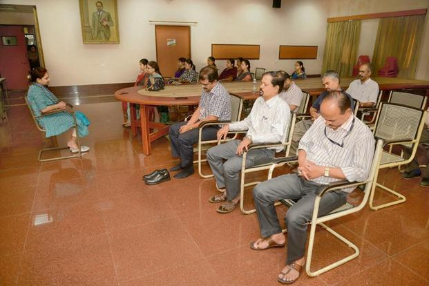 A meditation session at the Mumbai Port Trust office. Photographs: Abhijit Bhatlekar/Mint