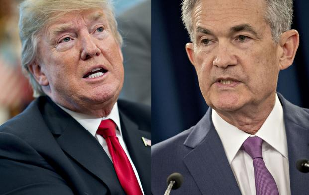 The Federal Reserve has raised rates five times since Donald Trump took office, including twice this year under Jerome Powell (right). Photo: Bloomberg