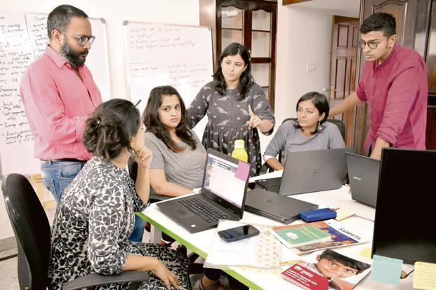 The GiveIndia team working on a crisis management strategy for the Kerala floods in Bengaluru. Photo: Jithendra M/Mint