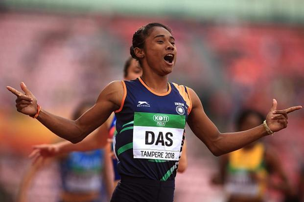 Hima Das celebrates after winning the gold medal in the women's 400m event at IAAF World U20 Championships on 12 July in Tampere, Finland. Photo: Getty Images