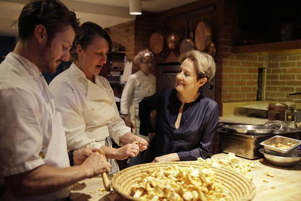 Alice Waters (right) with chefs at Chez Panisse in Berkeley, California, in 2017. Photo: AP