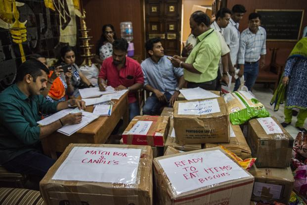Several IAS officers mobilized relief material. Photo: Pradeep Gaur/Mint