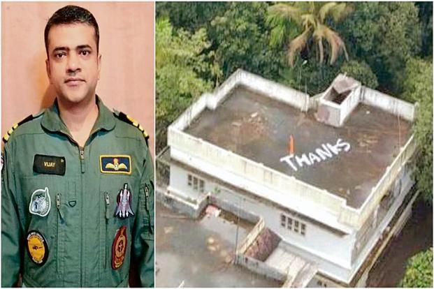 A message on a rooftop in Aluva for Commander Varma (left) and his team. Photo: PTI