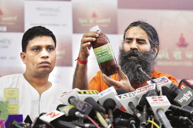 Baba Ramdev (right) and Patanjali Ayurved MD Acharya Balkrishna. Adani Wilmar has offered Ruchi Soya lenders ₹ 6,000 crore for the acquisition. Photo: HT