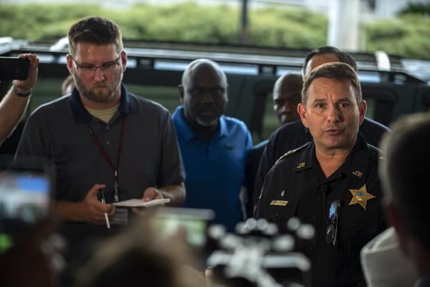 Jacksonville Sheriff Mike Williams (right) holds a news conference on Sunday. Photo: AP
