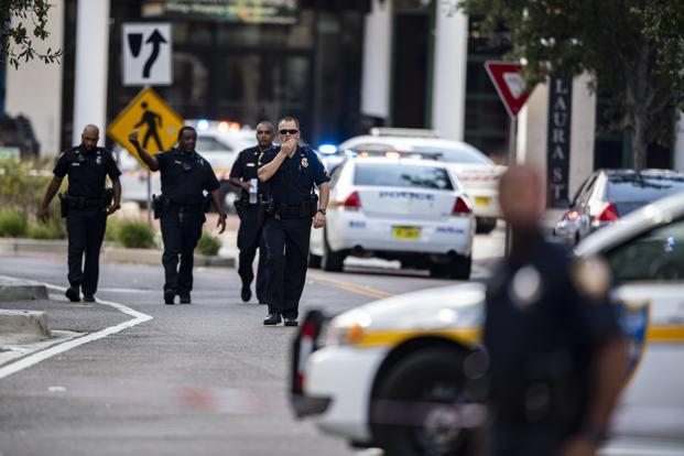 Police gather after an active shooter was reported at the Jacksonville Landing in Jacksonville, Florida, on Sunday. Photo: AP