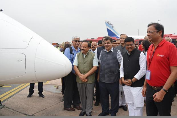 Ajay Singh, Dharmendra Pradhan, Nitin Gadkari and Harsh Vardhan stand next to a Bombardier aircraft operated by SpiceJet at IGI in Delhi on Monday. Photo: Bloomberg