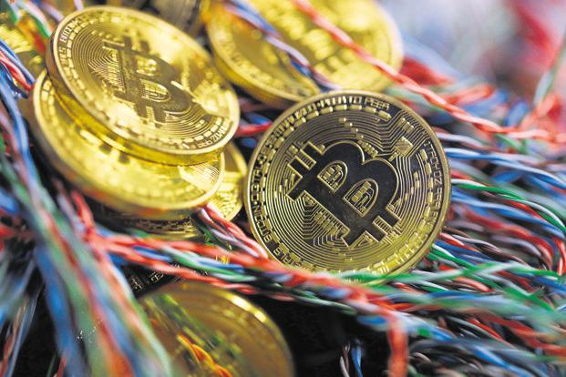 Other cryptocurrencies were swept up in the move, with Ripple, Ethereum and Litecoin also advancing at least 3.5%. Photo: Bloomberg