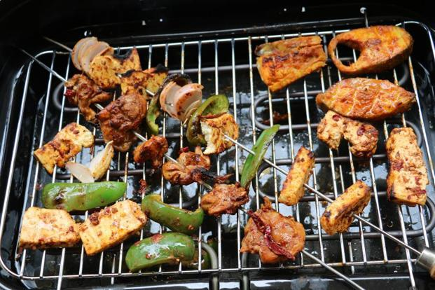 Chicken, fish or 'paneer' are perfect ingredients for a tabletop grill. Photo: Samar Halarnkar