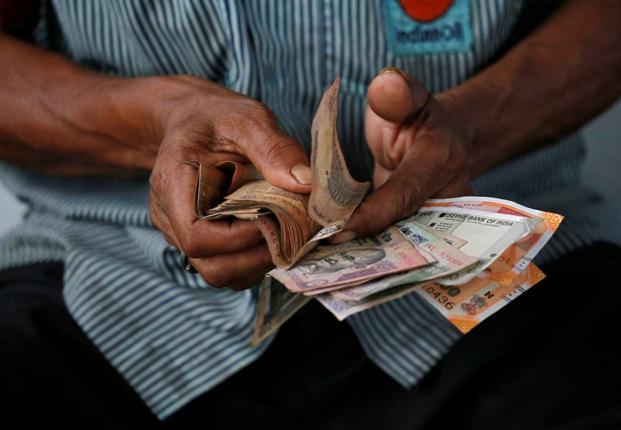 The rupee should be allowed to depreciate to contain the spiralling trade deficit. Photo: Reuters