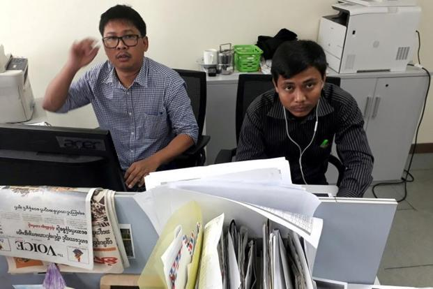 File Photo: Reuters journalists Wa Lone And Kyaw Soe Oo pose for a picture at the Reuters office in Yangon, Myanmar.