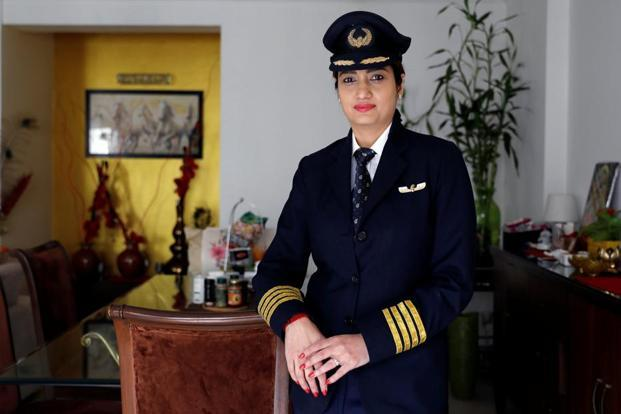 Shweta Singh, a Jet Airways pilot, poses for a picture inside her house in Gurugram. Photo: Reuters