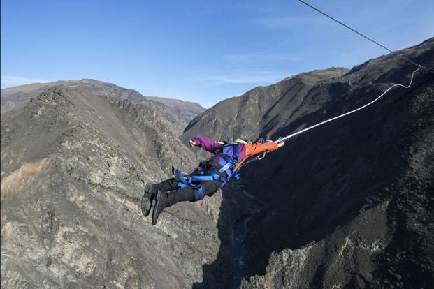 An adventure-enthusiast on the catapult in New Zealand's Nevis Valley.