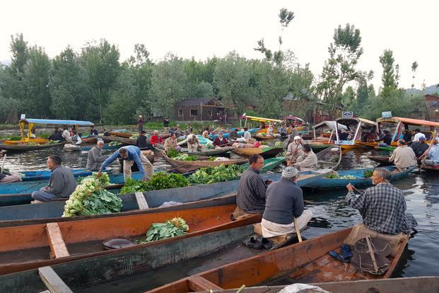 The floating market on Dal Lake is not just about commerce but also a social occasion for locals.