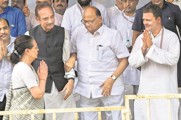 UPA chairperson Sonia Gandhi greets NCP chief Sharad Pawar and Congress president Rahul Gandhi in New Delhi on Monday. Photo: PTI.