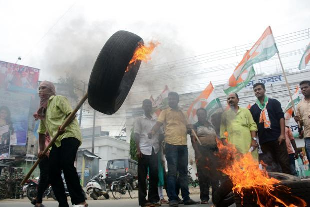 Protest against fuel price hike in Agartala. Since mid-August, petrol price has risen by over Rs 3.5 a litre and diesel by about Rs 4 per litre as rupee hit record low against the US dollar, making imports costlier. Photo: AFP